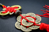 Antique Chinese coins on black background.