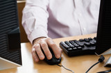 Midsection Of Senior Man Using Computer In Classroom