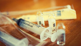 Syringe and empty vials on table macro selective focus shallow dof toned image