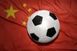 black and white football ball on the national flag of china