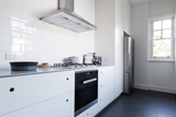 Monochrome clean white kitchen benchtop with appliances