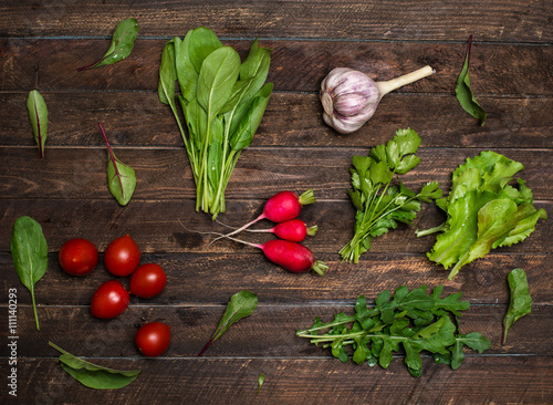 Foto op Canvas Natuur Fresh organic radishes cherry tomatoes and greens herbs