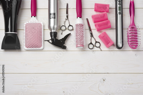 Professional hairdresser tools on wooden planks background with copy space Poster