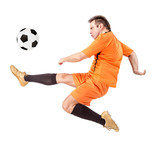 Soccer football player kicking the ball isolated on a white background