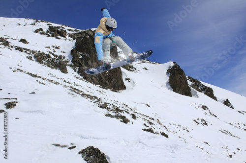 Snowboard rider jumping on winter mountains Poster