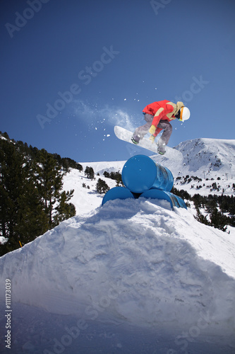 Poster Snowboard rider jumping on winter mountains