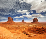 view of monument valley under a cloudy sky