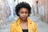 Fototapety Close up portrait of an attractive young black woman with afro hair