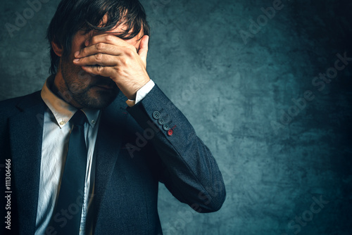 Unhappy businessman under stress after business project failure
