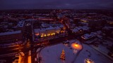 The Cityscape view of the Rakvere Estonia during the night time on a winter snowy season