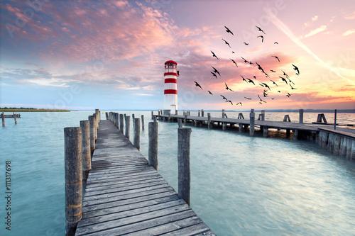 Poster abends am Neusiedler See, Leuchtturm im Sonnenuntergang
