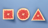 Various forms of grapefruit, on blue texture. perfect concept of fruits