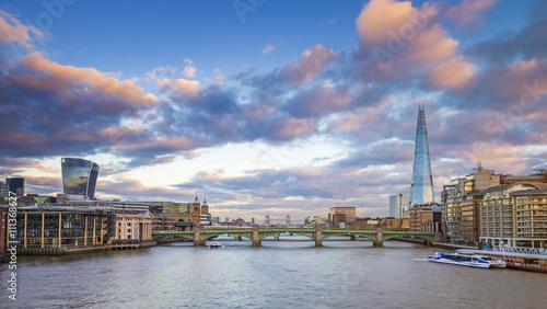 Fototapeta London skyline at sunset from Millennium Bridge with Tower Bridge, Shard and other famous landmarks - London, UK