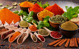 Variety of spices on kitchen table - 111377057