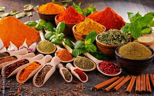 Fototapeta Variety of spices on kitchen table