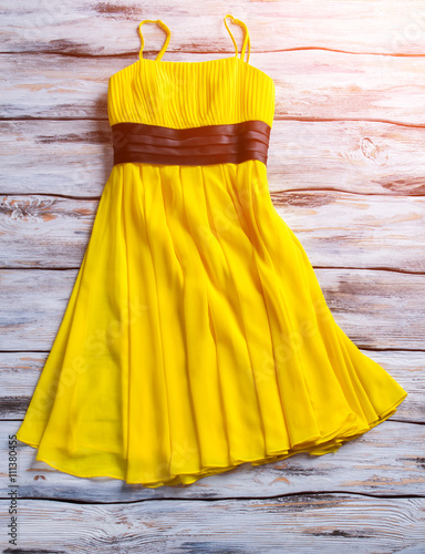 yellow summer dress yellow dress on wooden background woman 39 s garment for warm season. Black Bedroom Furniture Sets. Home Design Ideas