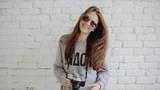 Portrait stylish pretty girl hipster in sunglasses with retro camera having fun