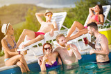 Young girl with boyfriend and friends at pool.
