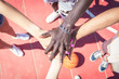 Group of multiracial basketball team hands