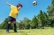 Soccer Boy Powerful Head Shot in the Park
