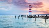 Abendstimmung am See, Leuchtturm und Steg