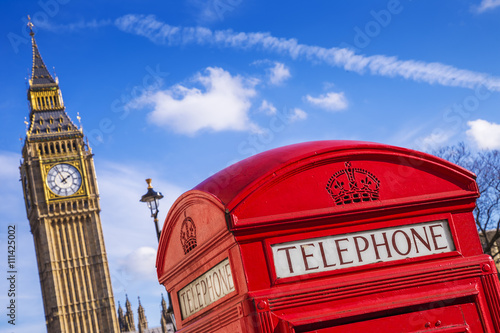 Poster London - Iconic Red telephone box with Big Ben at the background and blue sky -