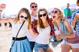 Fototapety Group of teenagers at summer music festival, sunny day