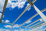 new structure girders on skeleton of the future roof against the blue sky