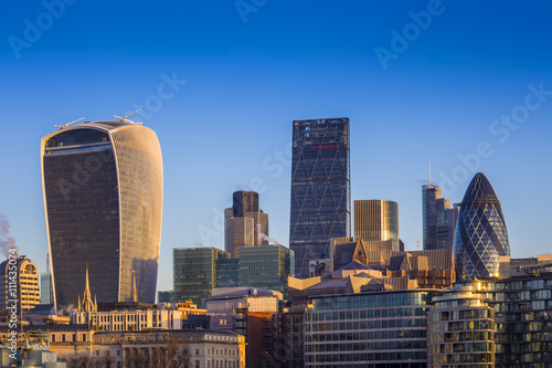 Fototapeta London, England - Bank. The world famous business district of London with skyscrapers and clear blue sky