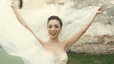 Wedding Bride Fun with Veil on Wind
