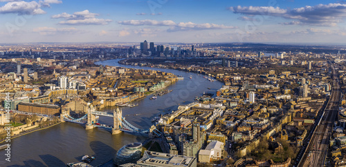 Fototapeta London aerial skyline view including Tower Bridge with red Double Decker Bus, skyscrapers of Canary Wharf and River Thames