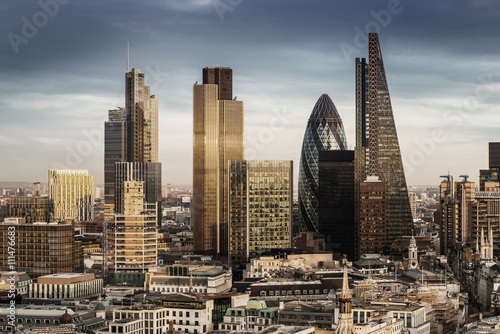 fototapeta na ścianę London, England - Business district with famous skyscrapers and landmarks at golden hour