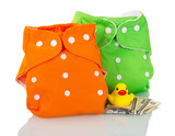 Modern cloth diapers, money, and  rubber duck isolated on white.