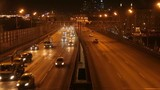A night timelapse top view of a highway with car lights and fast traffic