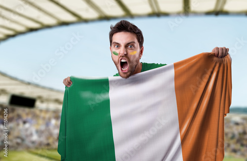 Poster Fan holding the flag of Ireland