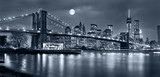 Night panorama of of New York City with the moon in the sky