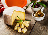Traditional italian cheese placed on wood