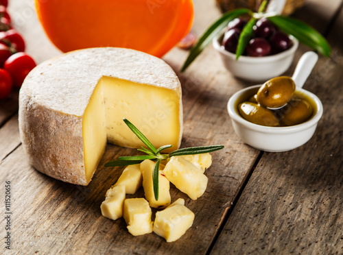 Naklejka Traditional italian cheese placed on wood