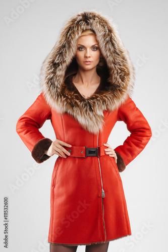 In de dag Art Studio attractive lady in red sheepskin coat posing with fur hood on he