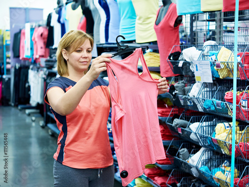 Poster Woman chooses sportwear for fitness