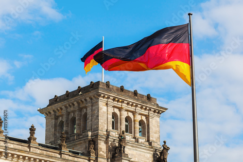 German Reichstag in Berlin, Germany, with national flags © Christian Müller