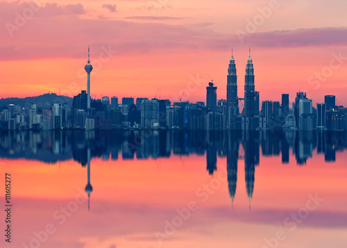 Poster Scenic view of Kuala Lumpur city skyline in sillhoute with full reflection
