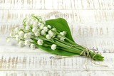 bunch of lily-of-the-valley on wooden background