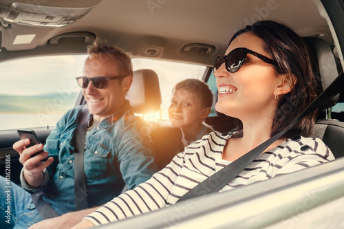Happy family riding in a car