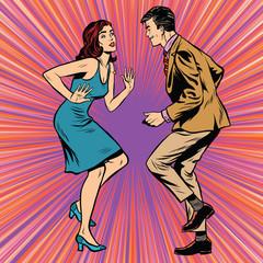Retro man and woman dancing pop art