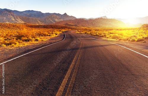 Red sunset over road at Valley of Fire State Park, southern Nevada, USA