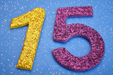 Number fifteen yellow purple color over blue background. Anniver