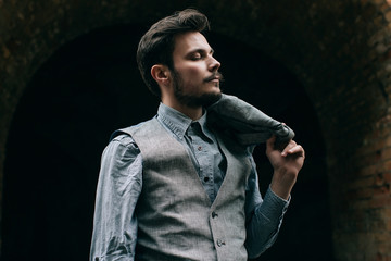 Portrait Elegant bearded vintage retro young handsome Businessman man hipster with mustache, Outdoor, jacket, ruins