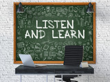 Listen and Learn Concept Handwritten on Green Chalkboard with Doodle Icons. Office Interior with Modern Workplace. White Brick Wall Background. 3D.
