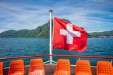 Waving Swiss flag on Lugano Lake boat
